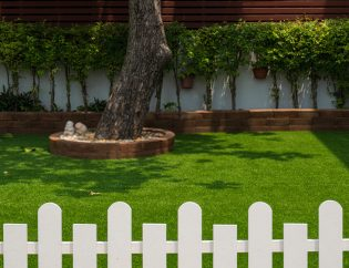 laying artificial grass on soil